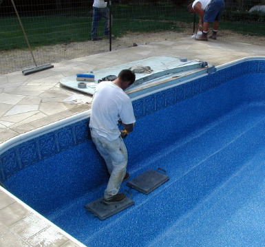 Inground swimming pool liners vinyl installing repair replacement for Cost of swimming pool installation inground