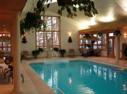 Home indoor swimming pools inground pool ideas swimming for Indoor swimming pool cost to build