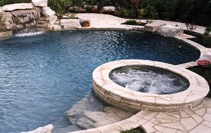 Swimming pool landscaping ideas pictures backyard rocks for Pool landscaping on a budget